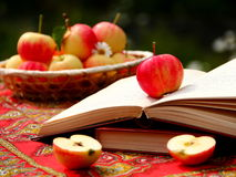 Apple Books. Books and apples on the table Stock Photography