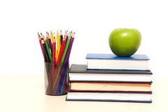 Apple, books and colored pencil Stock Image
