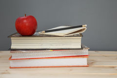 Apple and Books. On desk Royalty Free Stock Image