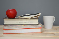 Apple and Books. On desk Stock Photos
