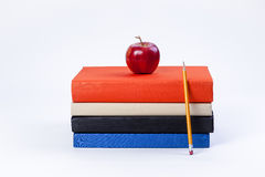 Apple on books and pencil. Stock Photo