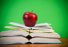 Apple on books Stock Images