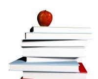 Apple on books Stock Photos