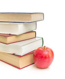 Apple and books on white background Royalty Free Stock Images