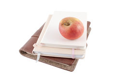 Apple and books on a white background. Books and apple isolated on white background Royalty Free Stock Photography