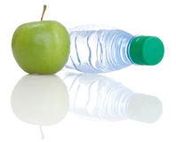 Apple and bottle. On a white background Stock Image