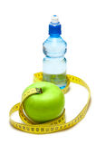 Apple and bottle with water Stock Image
