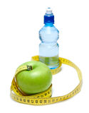 Apple and bottle with water Royalty Free Stock Photos