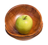 Apple In A Bowl. A single apple sitting in the top bowl in a stack, isolated against a white background Stock Image