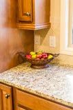 Apple Bowl on Granite Countertop royalty free stock photos
