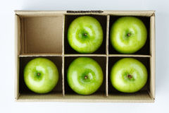 Apple in the box isolated  Royalty Free Stock Photo