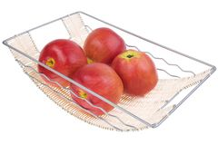 Apple on a braided stand Royalty Free Stock Images