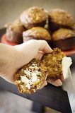 Apple Bran Muffins Being Buttered Stock Photography