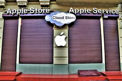 Apple brand name and logo. In an Apple store. External facade of an Apple store and service, with brand name and logo. Famous brand of computer and smartphone royalty free stock image