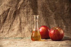 Apple brandy on table Stock Image
