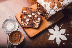 Apple bread with cocoa, fruit and nuts. On a rustic wooden table Royalty Free Stock Photo