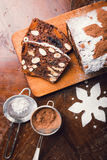 Apple bread with cocoa, fruit and nuts. On a rustic wooden table Stock Images