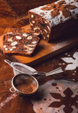 Apple bread with cocoa, fruit and nuts. On a rustic wooden table Royalty Free Stock Photos