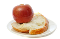 Apple with bread on plate Royalty Free Stock Photo
