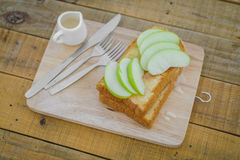 Apple with bread served on wood plate. Stock Images