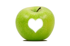 Apple with a bright heart shape Stock Photography