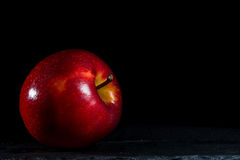 Apple brightness. Apple with black background and brihtness Royalty Free Stock Photography