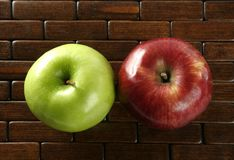 Apple on a brown tablecloth Royalty Free Stock Images