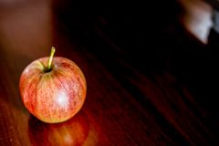 apple on brown wooden royalty free stock photo