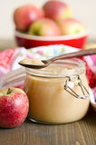 Apple butter. A can of apple butter and fresh apples Royalty Free Stock Photography