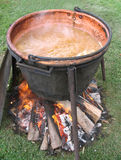 Apple butter boiling in an open kettle. Apple butter boiling over an open fire Stock Photography