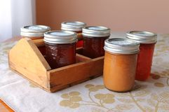 Apple butters and jellies. The caddy is full to take to the pantry Stock Photos