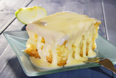 Apple cake. With vanilla sauce on a plate Royalty Free Stock Images
