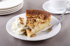 Apple cake with almond sliver whipped cream Stock Photos