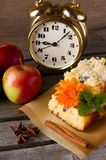 Apple cake with brass alarm clock and spice Stock Image