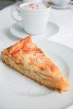 Apple cake and cappuccino Stock Photos