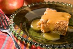 Apple Cake with Caramel Sauce. Warm apple cake covered with delicious caramel sauce. Perfect for many dessert and holiday themes stock photos