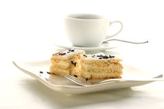 Apple cake and a cup of coffee with milk. Homemake apple cake and a cup of coffee with milk Stock Images