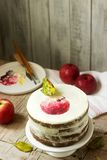 Apple cake with curd cream, decorated with painted apple on the background of autumn composition. Rustic style. royalty free stock photos