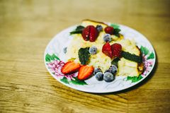 Apple cake is decorated with berries stock image