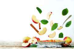 Apple cake with flying ingredients to bake it Royalty Free Stock Photography