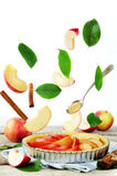 Apple cake with flying ingredients to bake it Stock Image