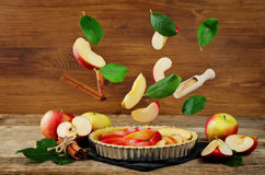 Apple cake with flying ingredients to bake it Royalty Free Stock Photo