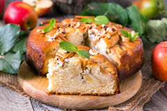 Apple cake with fresh fruits on wooden table Royalty Free Stock Photo