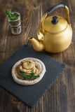Apple cake with mint with tea Stock Images