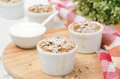 Apple cake with nuts in a white ramekin horizontal Royalty Free Stock Image