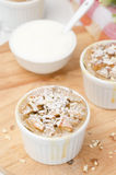 Apple cake with nuts in a white ramekin top view Stock Image