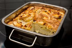 Apple cake in the oven-tray pan from the oven Stock Photos