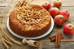 Apple cake. In plate on grey wooden table Stock Photo