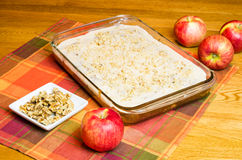 Apple cake with plate of walnuts and apples Stock Image