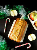 Apple cake with spices. Apple cake decorated with apple pieces surrounded by Christmas decorations stock photos